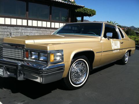 Golden cadillac car small