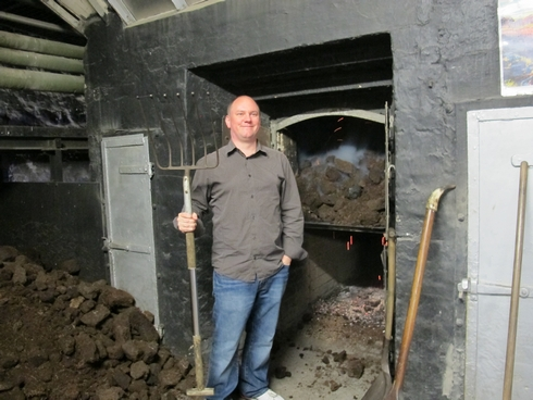 Peat fire Laphroaig Distillery Islay Scotland_tn
