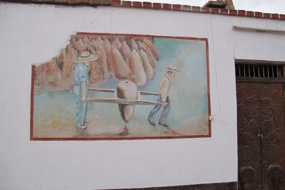 Lovera Distillery Pisco Peru painting carrying botijas