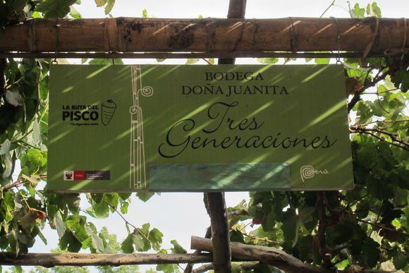 Bodega Dona Juanita Tres Generaciones Pisco Peru sign